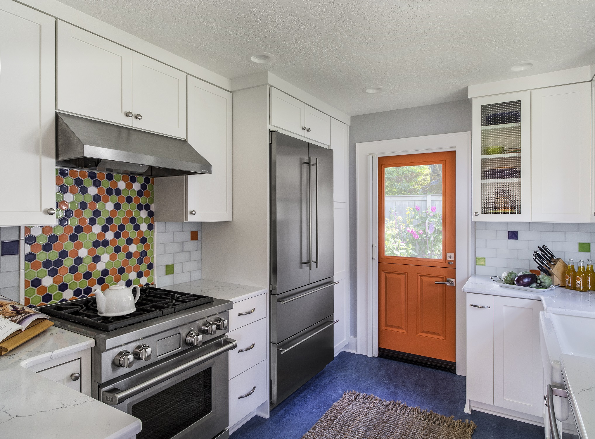 Kitchen remodel including colorful Dutch door